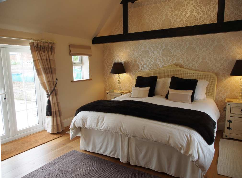 Master bedroom with french doors out to the pool langton lodge luxury hurstpierpoint holiday Double doors for master bedroom